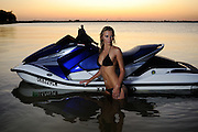 Emily Cochran in a bikini at sunset with Honda Aquatrax R-12 personal watercraft PWC