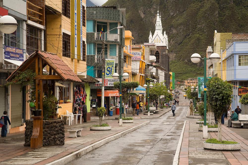 South America, Ecuador, Banos, main street lined with shops and restaurants