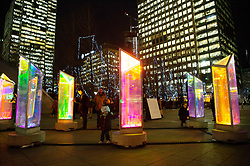 © Licensed to London News Pictures. 14/01/2019. London, UK. Commuters view a light installation titled Prismatica showing as part of the Canary Wharf Winter Light Festival. Photo credit: Ray Tang/LNP