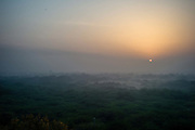 Sunrise over the Ridge in New Delhi, India. The Ridge is forest land on the outskirts of the city that act as the green lungs of the capital and extend for about thirty five kilometres.