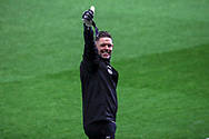 AFC Wimbledon goalkeeping coach Ashley Bayes giving thumbs up prior to kick off during the EFL Trophy match between AFC Wimbledon and U21 Arsenal at Plough Lane, London, United Kingdom on 8 December 2020.