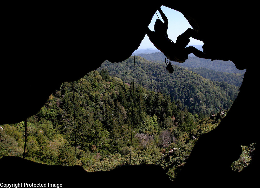 Ian Walters ascends Castle Rock State Park's Goat Rock via the roof of a cave.<br /> Photo by Shmuel Thaler <br /> shmuel_thaler@yahoo.com www.shmuelthaler.com