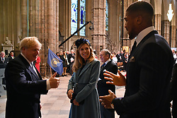 Prime Minister Boris Johnson and his partner Carrie Symonds speak with heavyweight boxer Anthony Joshua at the Commonwealth Service at Westminster Abbey, London on Commonwealth Day. The service is the Duke and Duchess of Sussex's final official engagement before they quit royal life.