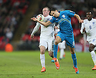 England's Wayne Rooney tussles with Slovenia's Branko Ilic<br /> <br /> - International European Qualifier - England vs Slovenia- Wembley Stadium - London - England - 15th November 2014  - Picture David Klein/Sportimage