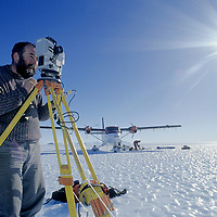 ANTARCTICA, Queen Maud Land. Jonathan Walton use laser theodolite to survey windswept, bare ice glacier for future use as landing strip for large, wheeled aircraft.
