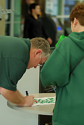 21 February 2017:  Matt the Cat Adams signs a Cat Towel for a fan during an College men's division 3 CCIW basketball game between the Augustana Vikings and the Illinois Wesleyan Titans in Shirk Center, Bloomington IL