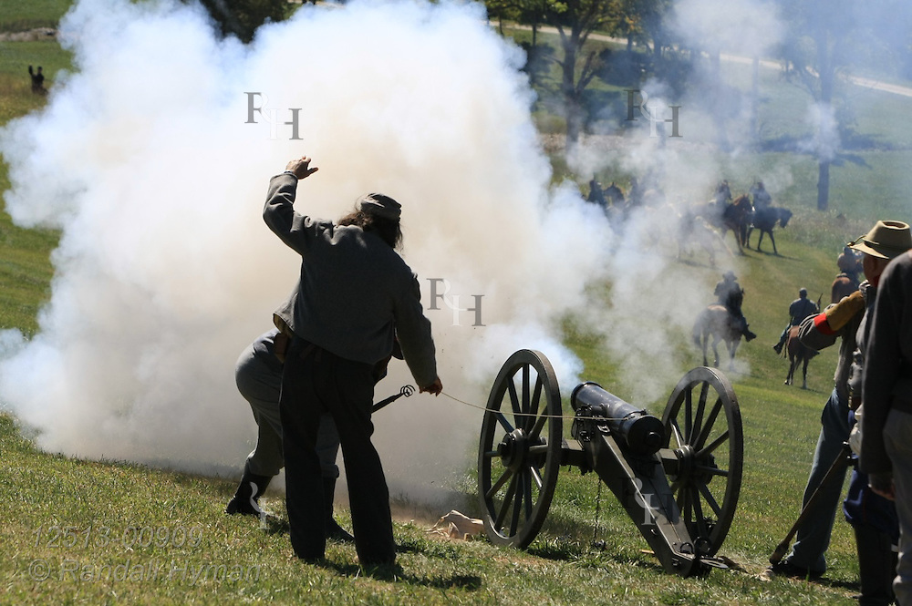 Confederate soldiers fire cannon during Civil War battle reenactment in Hermann, Missouri.