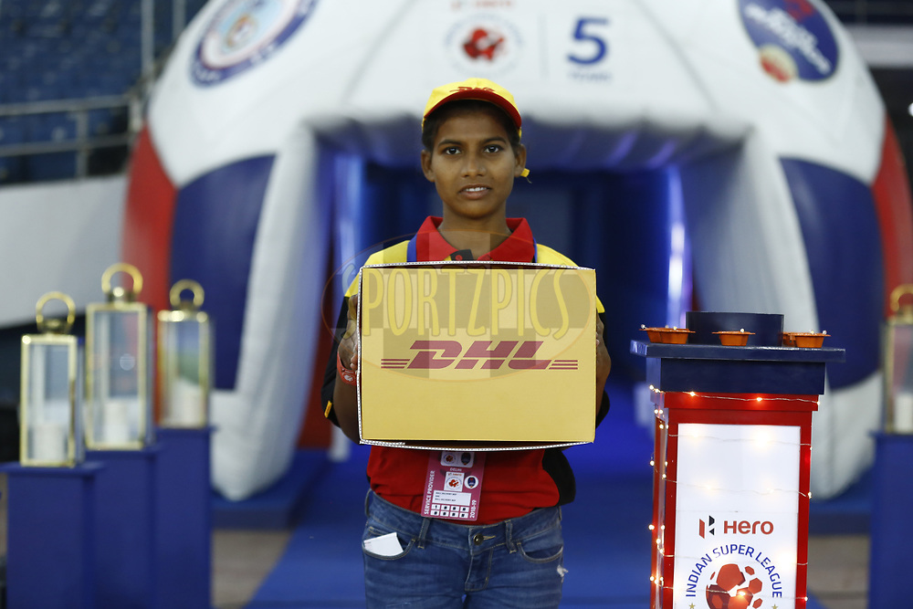 DHL delivery girl deliver the match ball during match 28 of the Hero Indian Super League 2018 ( ISL ) between Delhi Dynamos FC  and Jamshedpur FC  held at Jawaharlal Nehru Stadium, New Delhi, India on the 4th November 2018<br /> <br /> Photo by: Arjun Singh /SPORTZPICS for ISL
