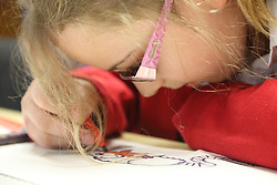 Girl  with visual impairment drawing and colouring. My sight children's group