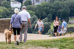 Licensed to London News Pictures. 17/09/2021. Dorking, UK. Wakers enjoy the late September sun on Box Hill in Surrey as weather forcasters predict a warmer few days ahead with highs of 24c tomorrow for London and the South East. Photo credit: Alex Lentati/LNP