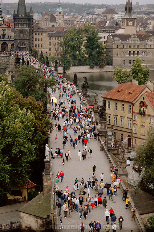 Pedestrians on the Charles Bridge. Prague, Czech Republic.