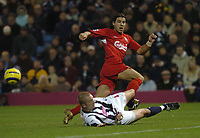 Milan Baros (Liverpool) is tackled by Thomas Gaardsoe (West Brom) West Bromwich Albion v Liverpool, FA Premiership, 26/12/2004. Credit: Back Page Images / Matthew Impey
