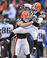 Cleveland's Mike Adams, right, jumps into the arms of Nick Sorensen after a special teams play.