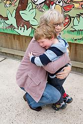 Young boy hugging his grandmother,