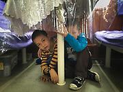 Young kids play hide and seek. Between Shaoguan and Chenzhou. Life in the train from Hong Kong to Urumqi, Xinjiang.