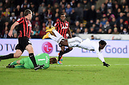 Wilfried Bony of Swansea city is denied by the save from QPR goalkeeper Robert Green. .Barclays Premier league match, Swansea city v Queens Park Rangers at the Liberty stadium in Swansea, South Wales on Tuesday 2nd December 2014<br /> pic by Andrew Orchard, Andrew Orchard sports photography.