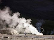 Man photographing El Tatio Geyser Field, El Tatio, Atacama, Chile