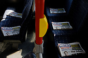 Copies of the free daily tabloid Metro newspaper have been carefully placed on upper deck seating on a London bus. headlines relating to the British government's latest economic budget have all been placed facing upwards on the empty seats during a journey across south London. The red rail is for the stop button, pressed by passengers who wish to disembark the bus. Metro was launched in 1999 as a free, colour newspaper for morning commuters. Commuters in 16 of Britain's major cities can pick up a free copy of the Metro as they travel to work in the morning. Every weekday morning some 1,134,121 copies are distributed across the UK making Metro the world's largest free newspaper and the fourth biggest newspaper in the UK.