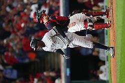 October 11, 2017 - Cleveland, OH, USA - The New York Yankees' Didi Gregorius crosses the plate after a solo home run as Cleveland Indians catcher Roberto Perez looks on in the first inning during Game 5 of the American League Division Series, Wenesday, Oct. 11, 2017, at Progressive Field in Cleveland. (Credit Image: © Phil Masturzo/TNS via ZUMA Wire)