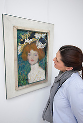 Woman looking at painting Portrait of a Woman (the Madrillenian) by Pablo Picasso at Kroller-Muller Museum in The Netherlands