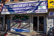 Soul Restoration City of Light Inc. / Ame Restaurèe Citè de Lumiére Inc., 1237 Flatbush Avenue, Brooklyn. [Misspellings in the French in the original sign.]