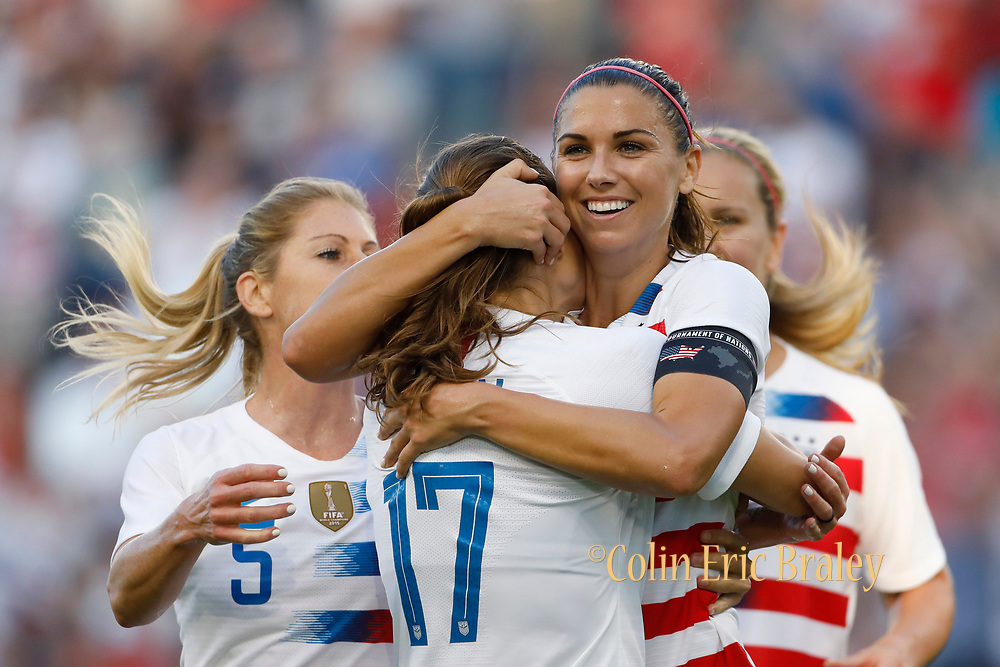 U.S. forward Alex Morgan, second from right, celebrates her hat trick with defender Tobin Heath (17) and other teammates during the second half of a Tournament of Nations soccer match against Japan in Kansas City, Kan., Thursday, July 26, 2018. (AP Photo/Colin E. Braley)
