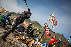 December 3, 2016 - A water protector chopping wood at Oceti Sakowin Camp (Credit Image: © Dimitrios Manis via ZUMA Wire)