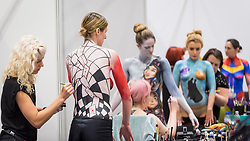 © Licensed to London News Pictures. 25/02/2019. LONDON, UK. Make-up artists apply Disney-inspired bodypaint to models at the Warpaint Zone at Professional Beauty, the UK's largest beauty and spa trade show, taking place at Excel London in Docklands.  Photo credit: Stephen Chung/LNP