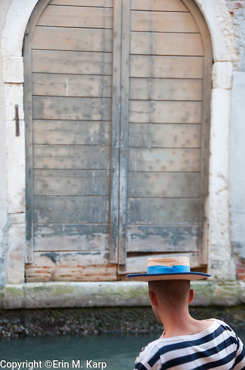 I happened upon this gondolier looking at the water & was struck by the repetition of lines in the doorway, in his hat, & in his striped shirt. I never saw his face, nor did he see mine, but I left with this candid image of a man in contemplation. A beautiful moment.