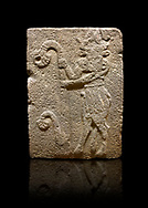 Hittite monumental relief sculpted orthostat stone panel from Water Gate Basalt, Karkamıs, (Kargamıs), Carchemish (Karkemish), 900-700 B.C. Anatolian Civilisations Museum, Ankara, Turkey. Bull-man holding the trunk of the tree. The waist-down part of the figure is in the form of a bull. <br /> <br /> On a black background. .<br />  <br /> If you prefer to buy from our ALAMY STOCK LIBRARY page at https://www.alamy.com/portfolio/paul-williams-funkystock/hittite-art-antiquities.html  - Type  Karkamıs in LOWER SEARCH WITHIN GALLERY box. Refine search by adding background colour, place, museum etc.<br /> <br /> Visit our HITTITE PHOTO COLLECTIONS for more photos to download or buy as wall art prints https://funkystock.photoshelter.com/gallery-collection/The-Hittites-Art-Artefacts-Antiquities-Historic-Sites-Pictures-Images-of/C0000NUBSMhSc3Oo