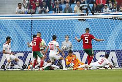 (l-r) Ghanem Saiss of Morocco, Karim Ansarifard of IR Iran, goalkeeper Alireza Beiranvand of IR Iran, Mehdi Benatia of Morocco, Ehsan Hajisafi of IR Iran