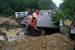 August 13, 2017 - Nepalgunj, Nepal - People work for the rescue process after the bridge collapsed caused by a flood at Gandheli river, along the East-West Highway. Floods and landslides triggered by incessant rainfall since Friday have killed at least 40 people. (Credit Image: © Xinhua via ZUMA Wire)