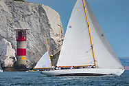 The oldest boat in the fleet, Dorade, built in 1929 from the USA, passes The Needles at the start of the 90th anniversary Rolex Fastnet Race on the Solent. A record fleet of 370 yachts will compete to win the Fastnet Challenge Cup.<br /> The 600 nautical mile race starts in Cowes, Isle of Wight, heading to the Fastnet Rock off the south west coast of Ireland and finishes in Plymouth.<br /> It is the world's biggest offshore race with 75% amateur sailors and professional yachtsmen competing against each other. <br /> Picture date Sunday 16th August, 2015.<br /> Picture by Christopher Ison. Contact +447544 044177 chris@christopherison.com