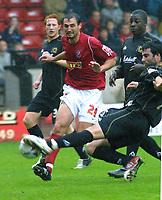 Photo: Dave Linney.<br />Walsall v Milton Keynes Dons. Coca Cola League 1.<br />08/10/2005. Craig Morgan clears the ball from the path of Walsall forward Ruben Dario Larrosa