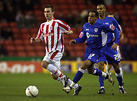 Photo: Paul Thomas.<br /> Stoke City v Millwall. The FA Cup. 05/01/2007.<br /> <br /> Peter Sweeny (L) of Stoke gets past Danny Senda (17) and Chris Zebroski of Millwall.