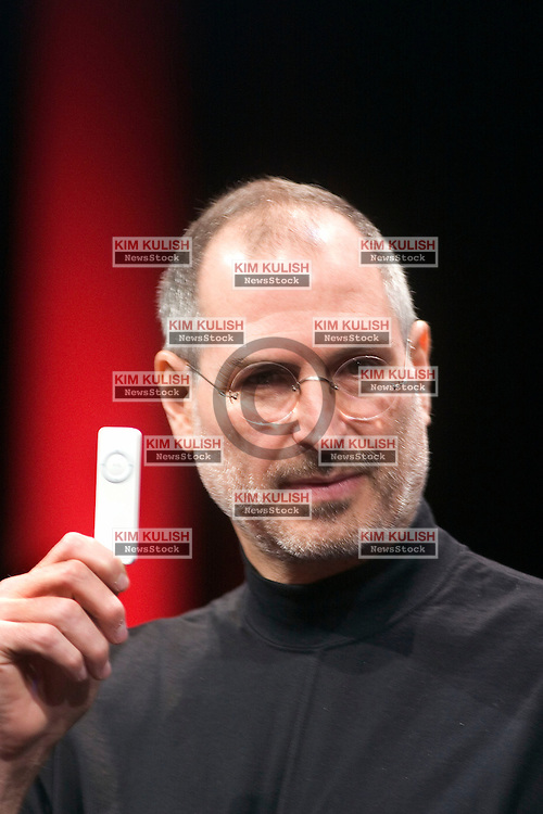 Apple CEO Steve Jobs displays the new iPod shuffle MP3 player at the 2005 Macworld Expo January 11, 2005 in San Francisco, California. Jobs announced several new products including the new Mac Mini personal computer starting at $499 and the iPod shuffle MP3 player for $99. Photo By Kim Kulish