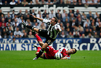 Photo: Andrew Unwin.<br /> Newcastle Utd v Fulham. The Barclays Premiership.<br /> 10/09/2005.<br /> Newcastle's Michael Owen (top) is fouled by Fulham's Carlos Bocanegra (bottom).
