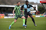 Aaron Pierre of Wycombe Wanderers blocks the ball from Rhys Murphy of AFC Wimbledon. Skybet football league two match, Wycombe Wanderers  v AFC Wimbledon at Adams Park  in High Wycombe, Buckinghamshire on Saturday 2nd April 2016.<br /> pic by John Patrick Fletcher, Andrew Orchard sports photography.