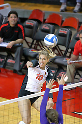 07 September 2011: Angela Rego moves to the net with an outside hit during an NCAA volleyball match between the Leathernecks of Western Illinois  and the Illinois State Redbirds at Redbird Arena in Normal Illinois.
