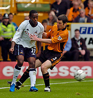 Photo. Jed Wee, Digitalsport<br /> NORWAY ONLY<br /> <br /> Wolverhampton Wanderers v Tottenham Hotspurs, FA Barclaycard Premiership, 15/05/2004.<br /> Wolves' Dennis Irwin (R) goes in strongly against Spurs' Rohan Ricketts.