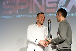 Igor Nenezic accepting the award in name of second best player Konstantin Vassiljev from Marinko Galic during the Slovenian men's football player of the year 2011 award at the SPINS XI  Nogometna Gala, on November 24, 2011 in Hotel Mons, Ljubljana, Slovenia. (Photo By Vid Ponikvar / Sportida.com)