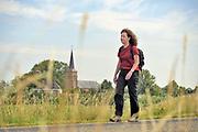Nederland, Kekerdom, 1-8-2019Minister Ingrid van Engelshoven can cultuur wandelt in de Ooipolder bij de buitendijkse kerk van Kekerdom. Het dorp ligt aan de andere kant van de dijk, en op de rand van natuurgebied de Millingerwaard.Foto: Flip Franssen