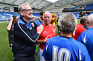 Tommy Charlton of England over 60's being congratulated at full time during the world's first Walking Football International match between England and Italy at the American Express Community Stadium, Brighton and Hove, England on 13 May 2018. Picture by Graham Hunt.