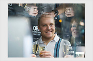 Formula One driver Valtteri Bottas among VIP guests and luxury watch display cabinets at a sponsorship event. Helsinki, December 17, 2014.