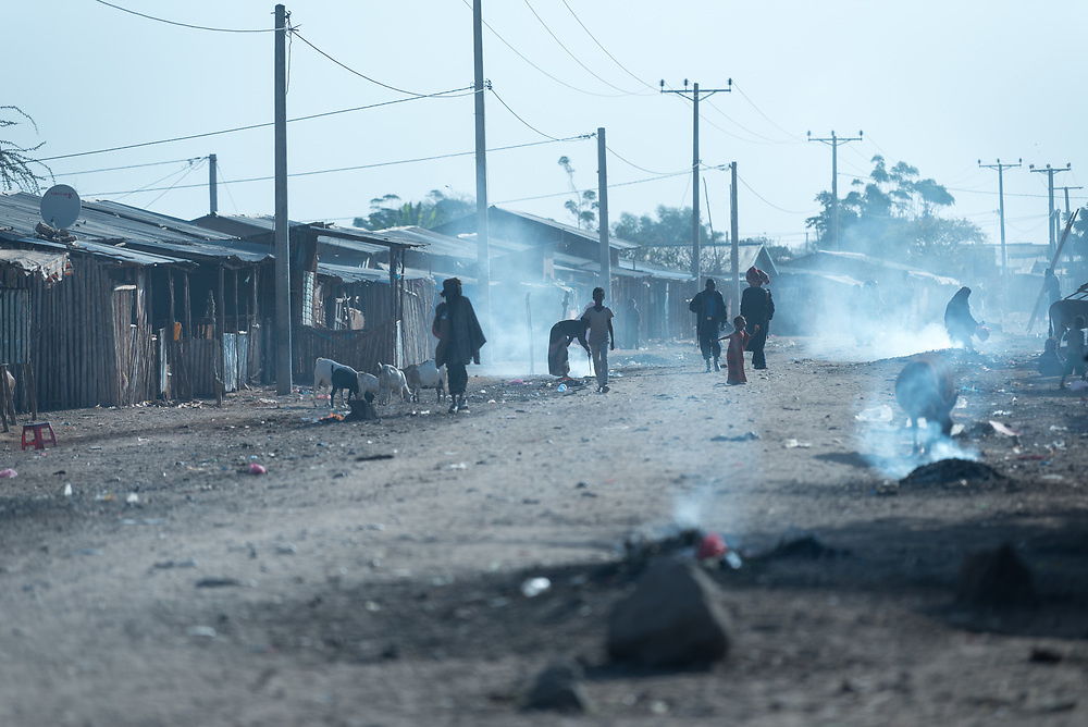 27 January 2019, Micha kebele, Seweyna woreda, Bale Zone, Oromia, Ethiopia: Morning rises in Micha town. Micha town is suffering drought. Dust and smoke fills the air, as night fires are dying out, lit by people who sleep on the streets.