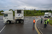 London, United Kingdom, May 22, 2021: McDonald's trucks appear to be locked out after about 50+ protestors gathered outside McDonald's distribution centre in Hampstead Industrial estate in North London on the early morning of Saturday, May 22, 2021 - to blockade the site for at least 24 hours, using trucks and bamboo structures, causing a significant disruption to the McDonald's supply chain. (Photo by Vudi Xhymshiti)