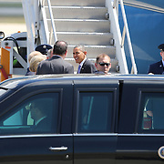 President Barack Obama exits Air Force One and shakes hands with Orlando Mayor Buddy Dyer, Congressman Alan Grayson and U.S. Senator Bill Nelson, at the Orlando International Airport on Thursday, March 20, 2014 in Orlando, Fla., enroute to the Valencia Community College West campus to speak about the role of women in the U.S. economy, as well as the challenges they still face. (AP Photo/Alex Menendez)