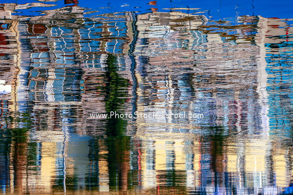 Boats reflecting in the water in a harbour
