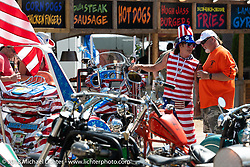 Vietnam War veteran Lance Blais with his American Flag trike at the Broken Spoke Saloon during Laconia Motorcycle Week. NH, USA. Tuesday, June 12, 2018. Photography ©2018 Michael Lichter.
