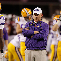 Jan 7, 2011; Arlington, TX, USA; LSU Tigers head coach Les Miles watches his team during warm ups prior to kickoff against the Texas A&M Aggies in the 2011 Cotton Bowl at Cowboys Stadium.  Mandatory Credit: Derick E. Hingle